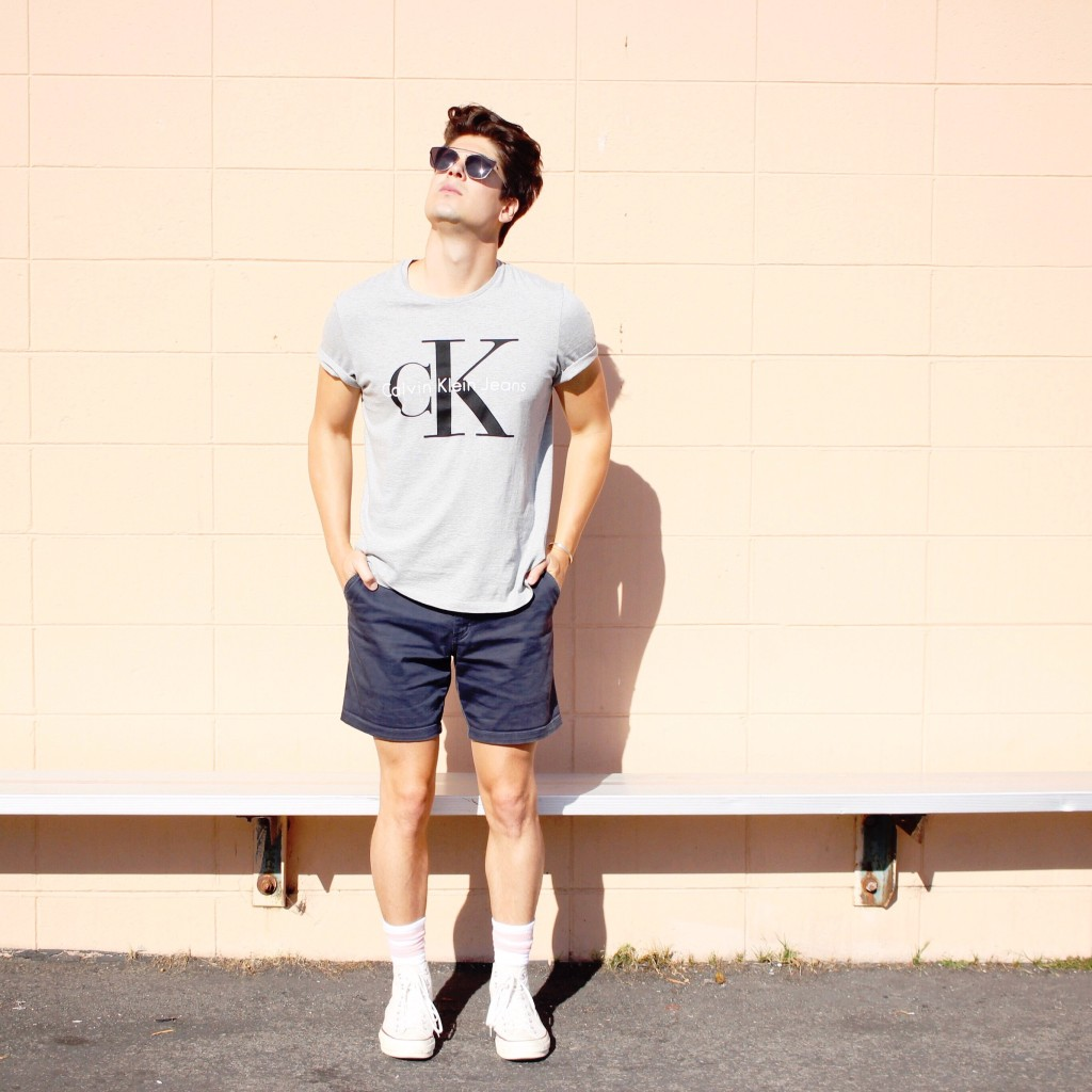 yummertime wearing socks and shorts with Calvin Klein Jeans tee